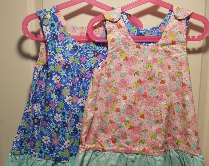 Reversible Dress, jumper, sundress, pinafore Pink underwater print and blue daisy with aqua ruffle
