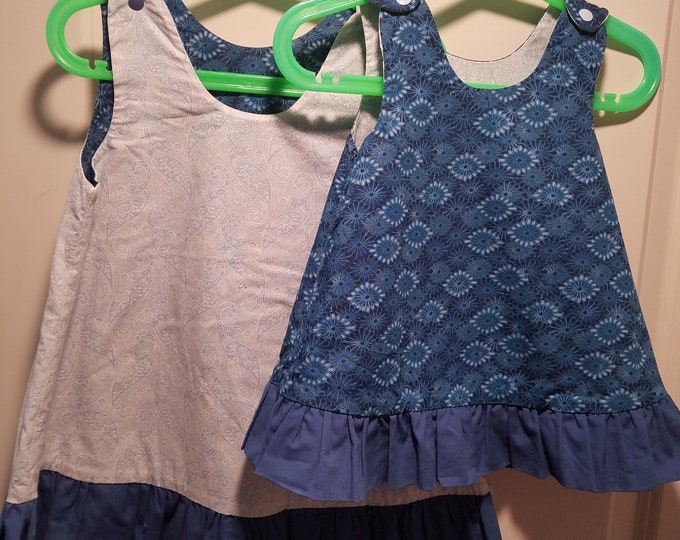 Clearance last ones reversible 6-9 months and 4T blue sunburst and light blue paisley with a blue ruffle