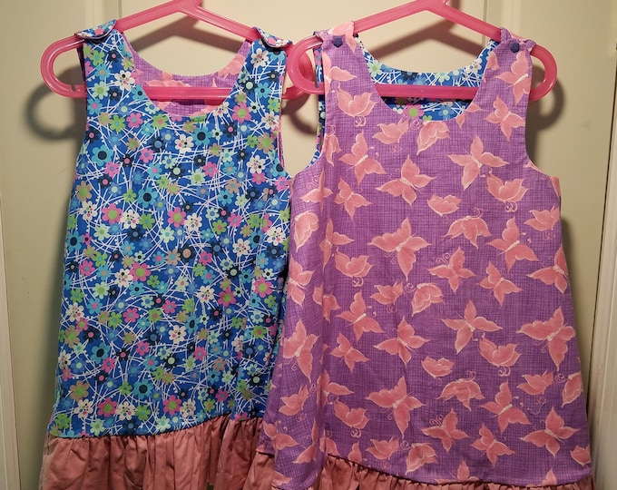 Reversible Dress, jumper, sundress, pinafore Toddler and Kids sizes Blue retro daisies and a purple with pink butterflies with pink ruffle