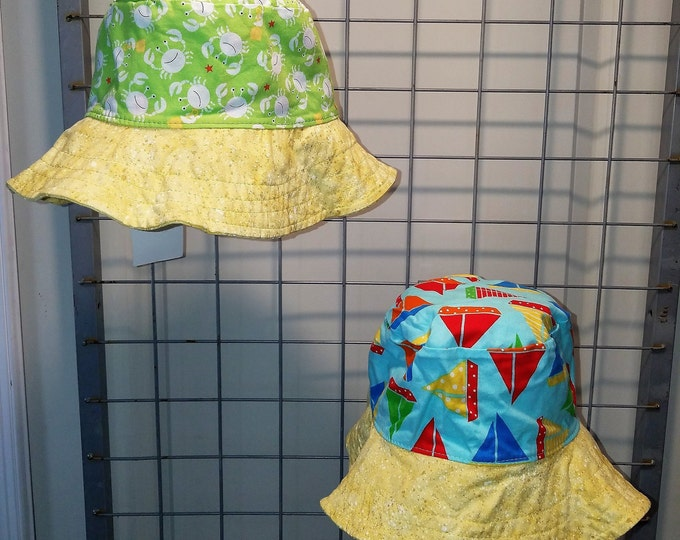 Reversible bucket hats sizes 17 to 20 inches Green crabs and Sailboats