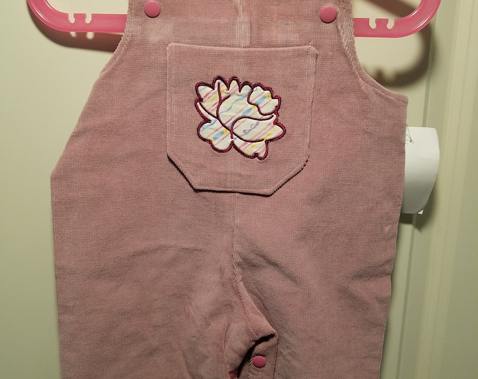 Mauve long corduroy overalls 3-6 months with rose applique embroidered on a chest pocket