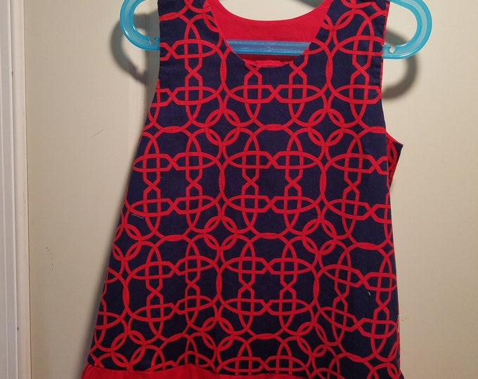 Jumper, sundress, pinafore, dress Navy and red wicker print with red facings and ruffle