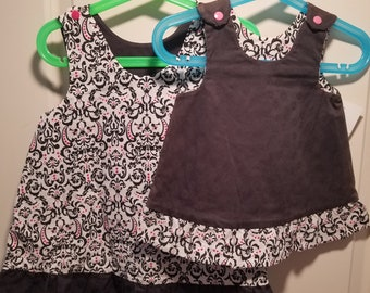 Clearance Sun faded Reversible Dress 3-6 months, 3T and 4T Black roses and white black and pink damask with ruffle