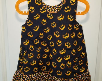 Spooky faces Halloween A-line dress with candy corn ruffle