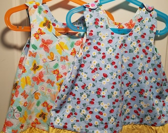 Reversible Dress, jumper, sundress, pinafore Kids sizes strawberry plants and colorful butterfly with yellow ruffle
