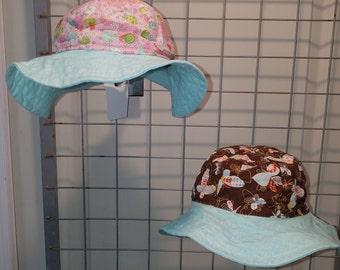Reversible Sun Hat with pink under water print and brown butterfly print with a light aqua brim