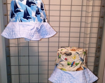 "Reversible bucket hats sizes 17"" to 20"" Light blue with white and navy sailboats and forest animal with a light blue brim"