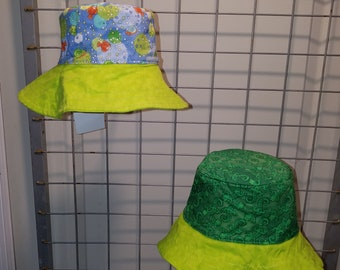 "Reversible bucket hats sizes 15"" to 20"" Blue froggin print and green lizards print with bright green brim"