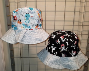 """Reversible bucket hats sizes 15"""" to 24"""" Pirate themed"""