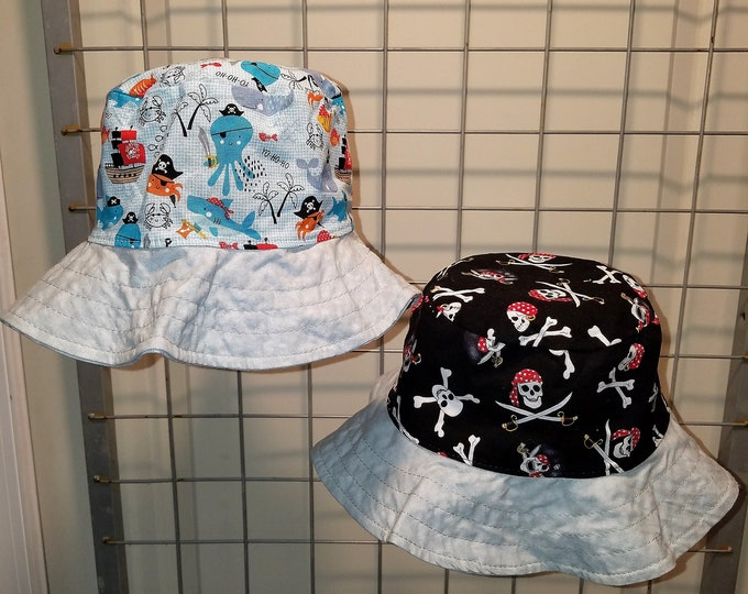"Reversible bucket hats sizes 15"" to 24"" Pirate themed"