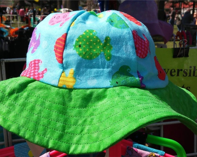 Reversible Sun Hat Rainbow fish and ladybug with green brim Reversible