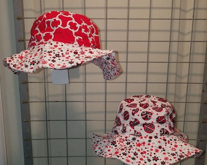 Reversible Sun Hat with Lady bugs and red chain link and daisy print brim all in Red, White and Black
