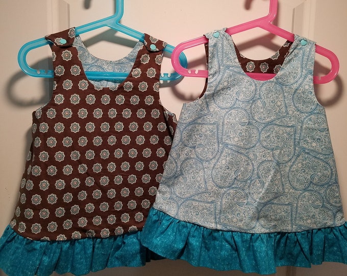Reversible Dress, jumper, sundress, pinafore Toddler and Kids sizes aqua and gold hearts and brown medalions with aqua ruffle