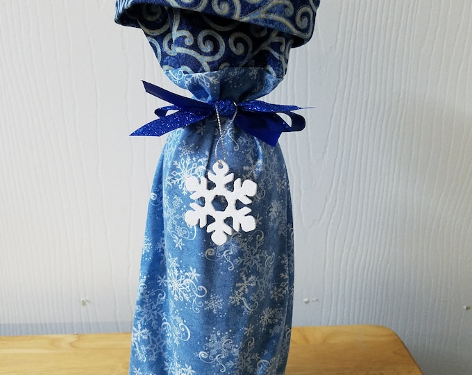 Ready to ship Blue snowflake and swirl fabric Christmas wine bottle gift bag with blues and gold cuff and snowflake decoration