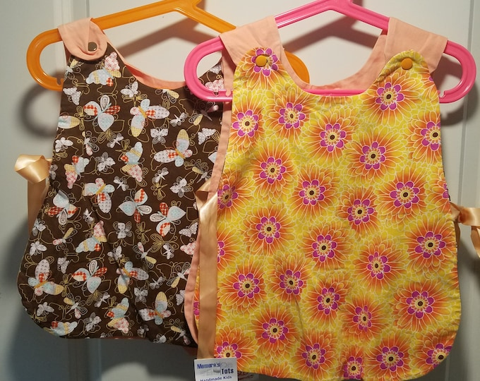 Clearance last ones with bloomers 1T and 2T Reversible top in brown butterfly, bright daisies and peach