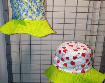 Reversbile bucket Hat Strawberry and green butterfly with a bright green brim