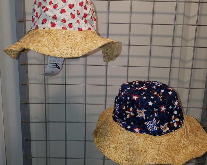 Reversbile Sun Hat Patriotic pinwheels and either Aqua Hearts or little lady bugs  with gold brim