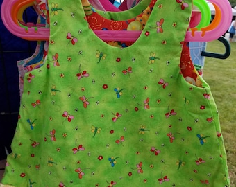 Clearance sun faded shoulders Reversible a-line Dress sizes 0-3 month and 3T Bugs and dragonfly  with yellow ruffle