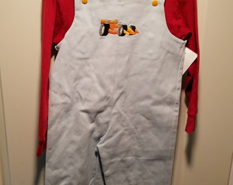 Light blue denim overalls with embroidered race car
