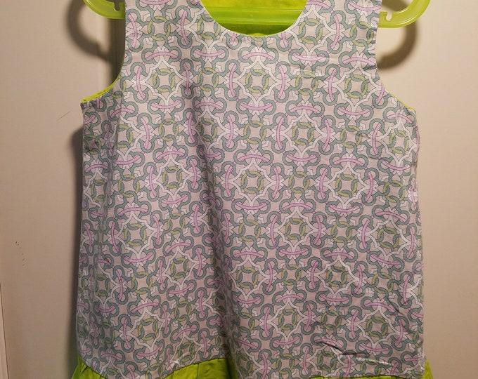 Jumper, sundress, pinafore, dress geometric print with green ruffle and facings