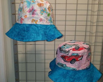Reversible Bucket Hat in Classic cars and choice of butterfly or garden print in Aqua brim or octopus with pink brim
