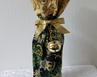 Ready to ship snowflake wine bottle bag in green and gold with gold swirl cuff and jingle bell