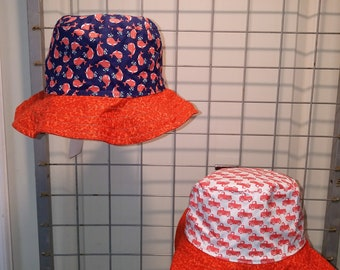 "Reversible bucket hats sizes 15"" to 20"" Little orange whales and little orange trucks with a fire orange brim"