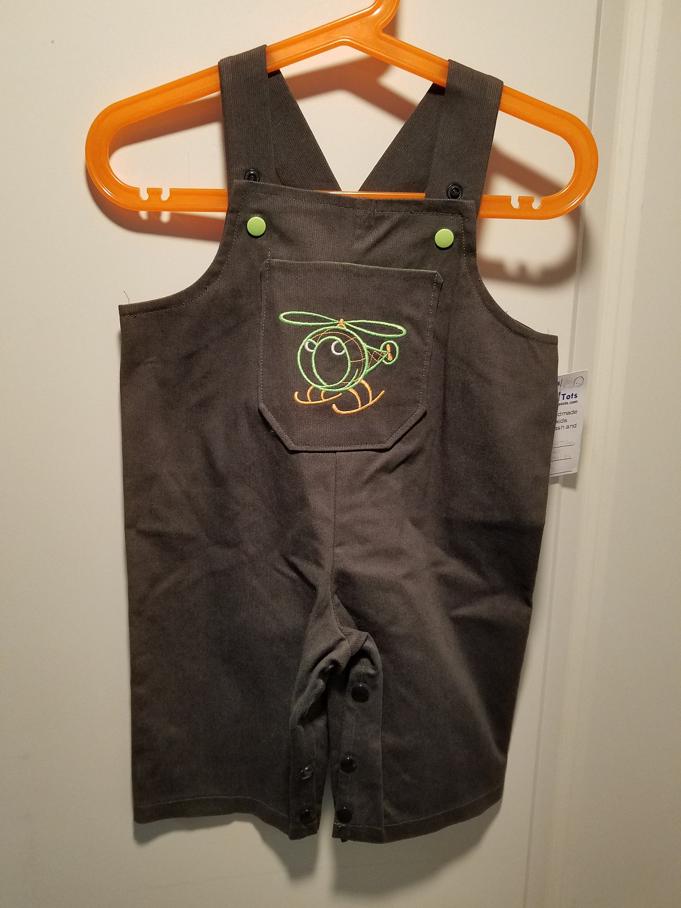 Clearance green twill overalls 6-9 months with helicopter
