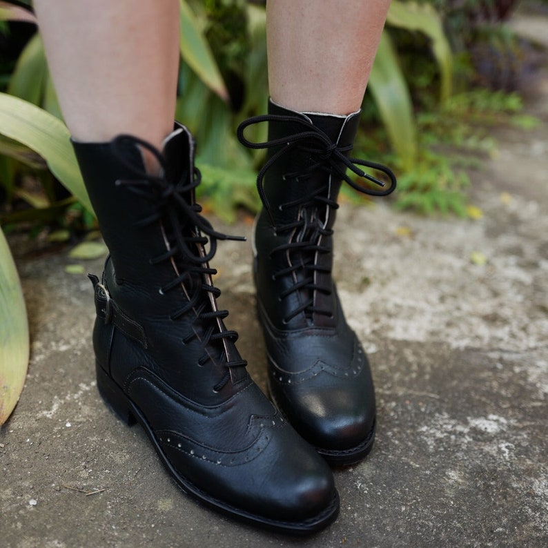 History of Victorian Boots & Shoes for Women Black Victorian Lace Up Boots with Brogue Pattern  AT vintagedancer.com