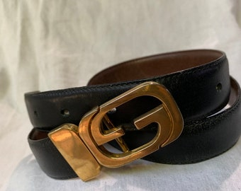 593c15576 Vintage iconic GUCCI reversible logo black and brown leather belt with logo  unisex medium