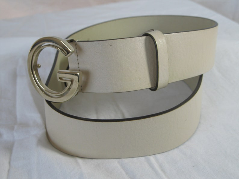 84ccb6e6a Vintage iconic GUCCI ivory single G leather belt with logo   Etsy