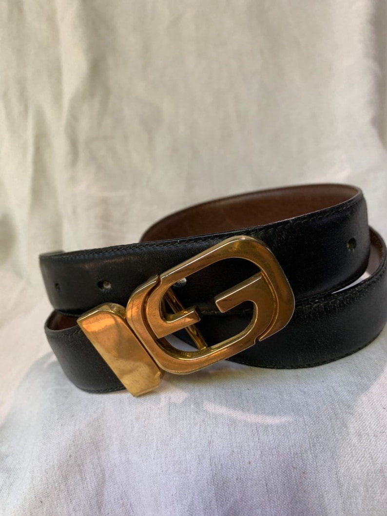 354f88e42 Vintage iconic GUCCI reversible logo black and brown leather   Etsy