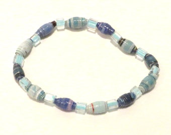 Blue upcycled bracelet with magazine rolled paper beads and square seed beads. Recycled stretch bracelet.