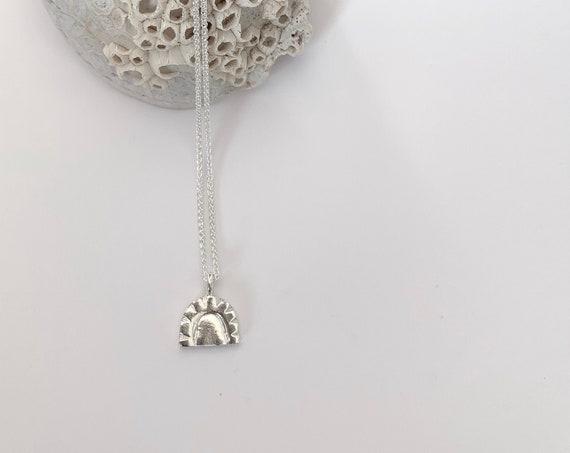 WEST silver pendant