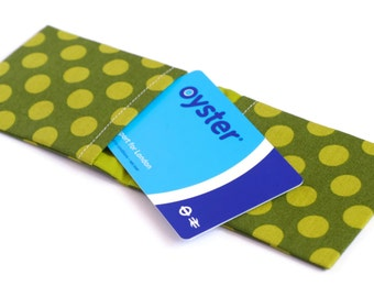 Polka dot Oyster card holder in green. Travel card wallet - credit card, metro and subway ticket case.