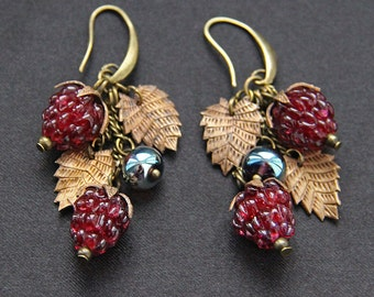 Lampwork glass berries earrings with bronze leaves. Red color.