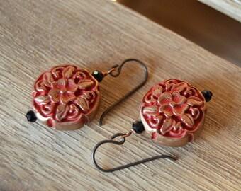 Antiqued floral cinnabar dangle earrings.