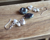 Midnight pearl coin pearl dangle earrings.