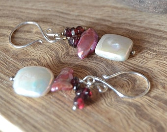Freshwater pearl dangle earrings with garnet accents.