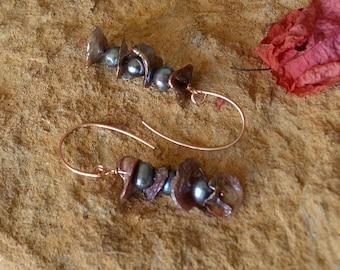 Freshwater pearl dangle earrings on rose gold.