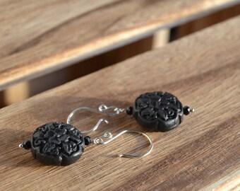 Floral cinnabar dangle earrings.