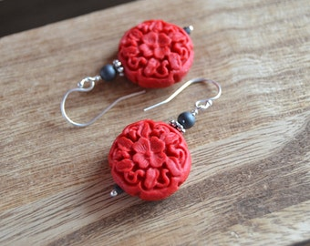 Scarlet cinnabar dangle earrings with charcoal matte glass accents.