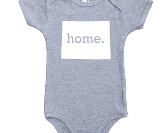 Homeland Tees Wyoming Home Unisex Baby Bodysuit