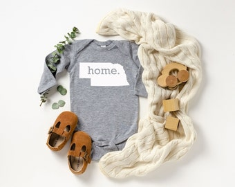 Homeland Tees Nebraska Home Unisex Long Sleeve Baby Bodysuit