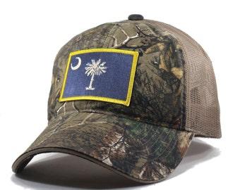 9c5005fa8019e Homeland Tees South Carolina Flag Hat - Realtree Camo Trucker