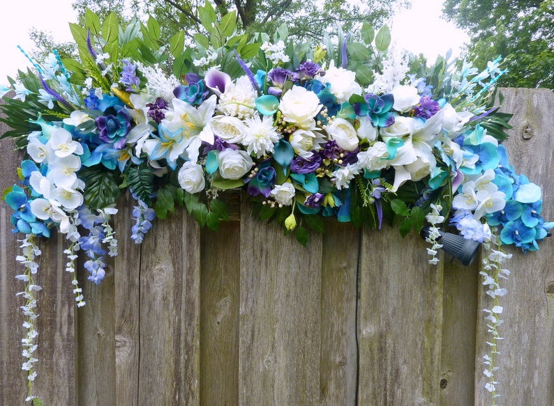 Tropical Wedding Arch Flowers Turquoise Purple And White Wedding Flowers Wedding Decorations Wedding Arch Swag