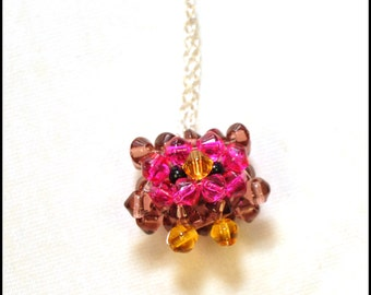 Purple and pink beaded owl pendant