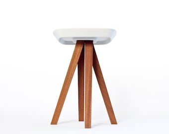 Stool, pedestal table or end of sofa in exotic wood and concrete with interlocking assembly without tools