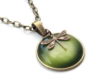 Vintage necklace with green cateye stone and a small dragonfly