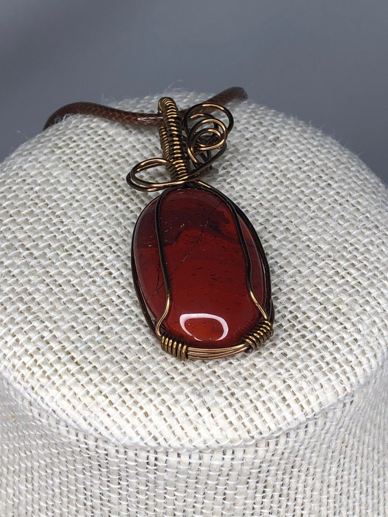 Redish Brown Stone Pendant Natural Oval 20mm x 30mm  with a silver Necklace 20